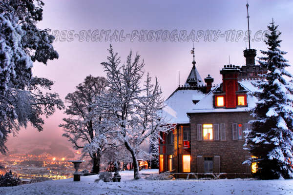 This is a HDR photo of a Luzern Switzerland Music school castle with the Luzern city lights glowing in the background