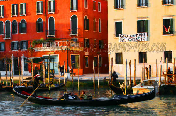 Gondola cruising the wet streets in Venice Italy.