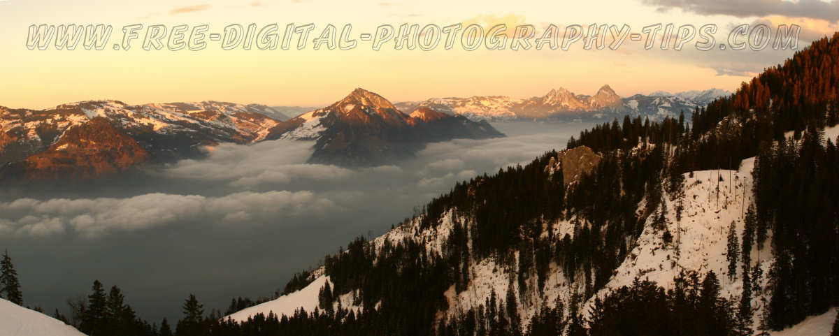 Panoramic view of some snowy swiss alps and clouds during the sunset from Klewenalp ski resort in Switzerland on December 29th, 2008.