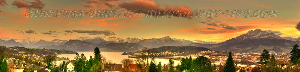 View from on a hill looking down on Luzern Switzerland with Mount Pilatus and the Swiss Alps in the background on a evening with a great sunset on March 2nd, 2008.