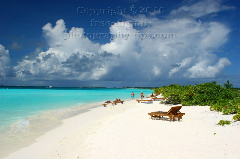 fabulous white sandy beach Sun Island Maldives soft waves Indian Ocean rolling beach