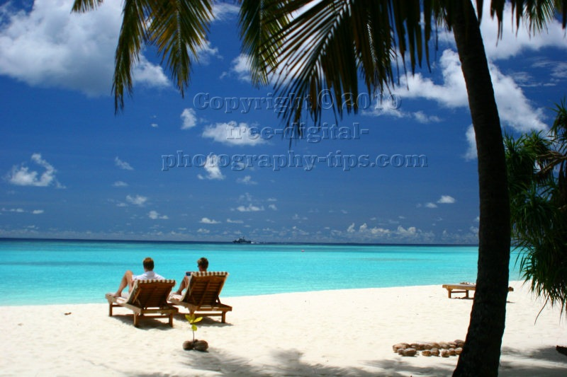 lucky tourists relaxing soaking hot sun white sandy beach Sun Island Maldives