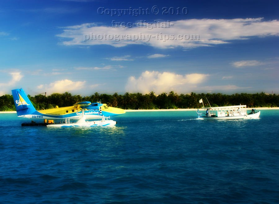 Trans Maldivian seaplane delivering happy tourists boats waiting Maldives vacation island