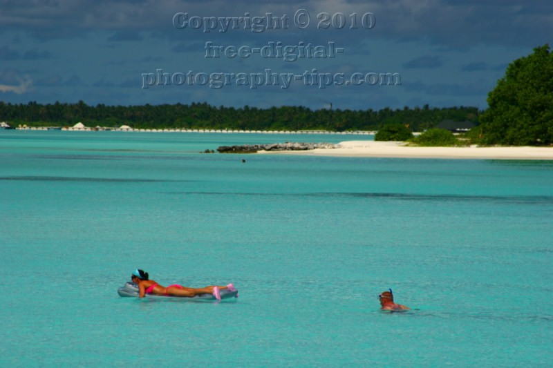 sun island maldives beach sand swimming snorkeling turquoise indian ocean