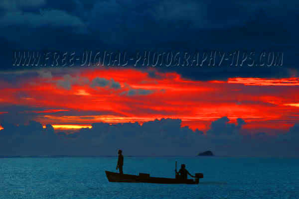 Awesome sunset some fishermen cruising Indian Ocean near Sun Island Maldives
