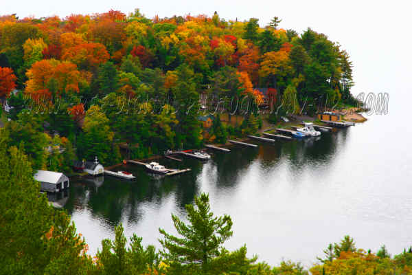 Great fall colors foliage and boats on Lac La Belle lake in the Upper Peninsula of Michigan.