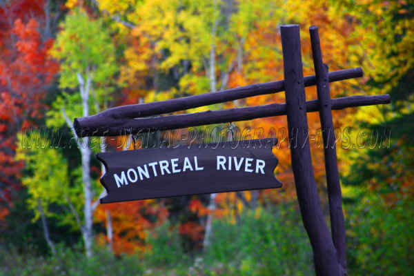 Montreal River sign and great fall foliage colors in the Upper Peninsula of Michigan.