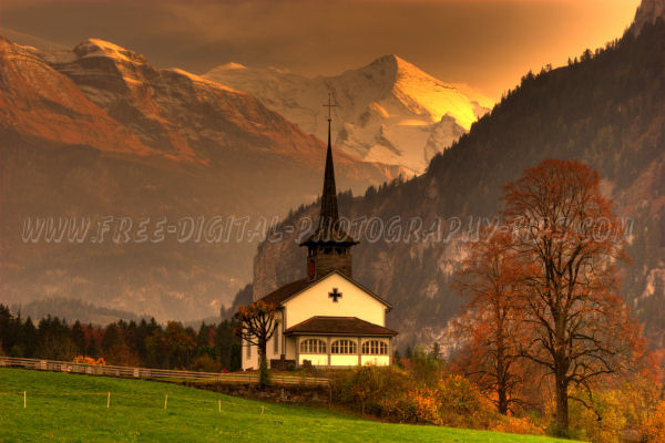 Beautiful sunset by a church in Kandergrund Switzerland with the swiss alps in the background, on Oct. 18th, 2008.