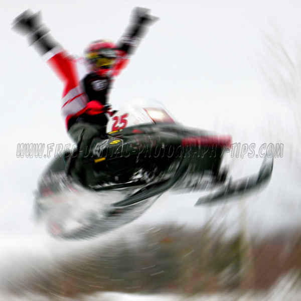 Cole as the Snowmobiler doing a no hands jump with his old Polaris